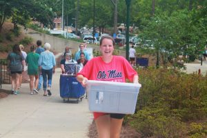 student carrying box