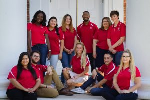 Graduate assistants on front porch of Lyceum