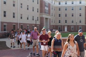 families taking a tour of student housing